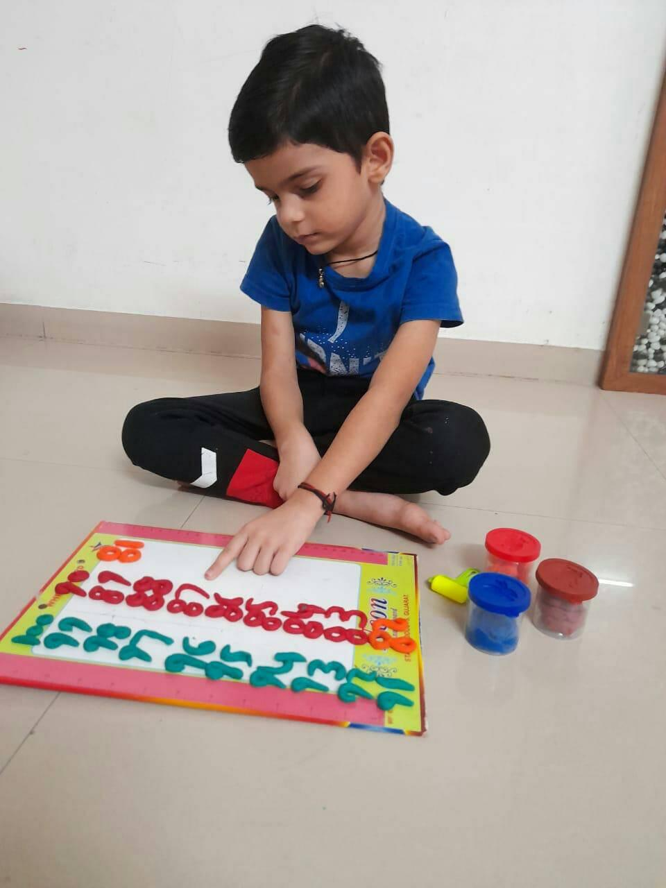 Clay Moulding Activity by Pre Primary kids.